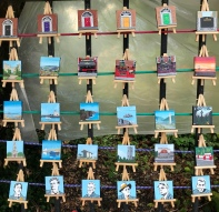 Many mini paintings with easel
